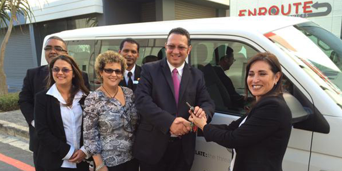 Lauren Gillis hands over the keys to Shane Jacobs, Managing Director of Enroute Transport Services
